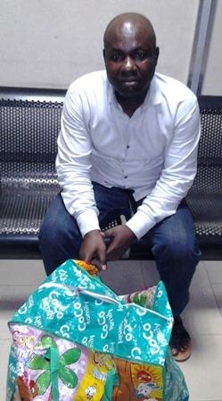 odeyemi ademola ayodeji with his bag