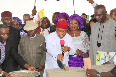 Gov. Theodore Orji of Abia state laying the foundation stone of the new world class event centre in Umuahia. with him from L-R are Rt. Hon. Ude Okochukwu, speaker state house of assembly, Sir Emeka Ananaba, deputy governor, Lady Mercy Orji, wife of the governor and Engr. Ndubisi Mbaka M/D Trademore Investments