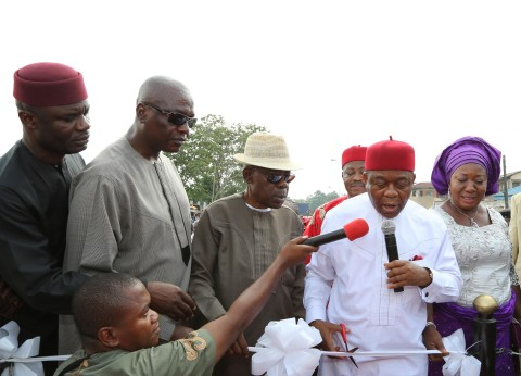 Gov. Theodore Orji of Abia state cutting the tape to commission the renovated ultra modern Okpara square in Umuahia. with him from L-R are Rt. Hon. Ude Okochukwu, speaker state house of assembly, Ndubisi Mbaka M/D Trademore Investments, Sir Emeka Ananaba, deputy governor and Lady Mercy Orji, wife of the governor.