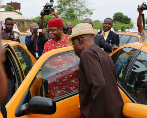 Gov. Theodore Orji of Abia state inspecting some of the 200 vehicles procured for the 2014 youth empowerment programme of Arochukwu, Ohafia and Bende at Bende Local Government headquaters in Bende LGA. with him is his deputy Sir Emeka Ananaba.