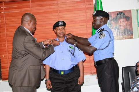 CP Alkali Baba Usman being decorated with his new rank by the IGP