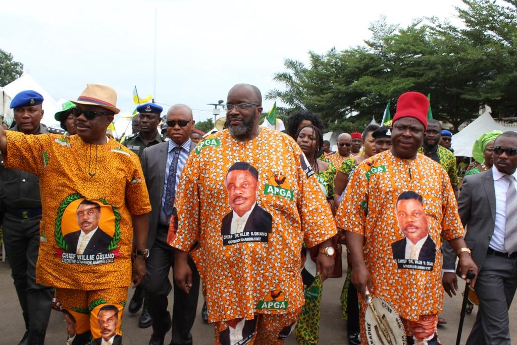 Obiano acknowledging cheers at Nnewi