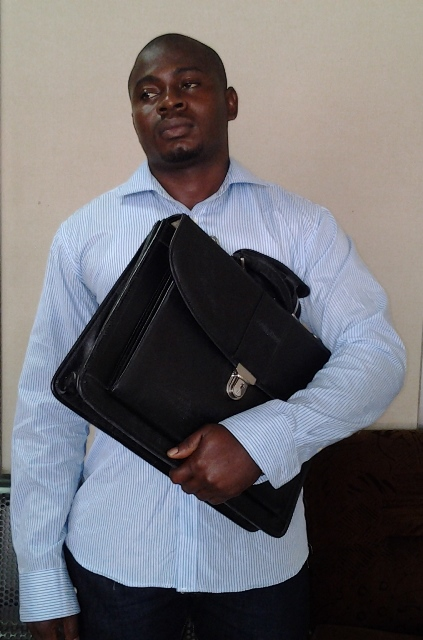 agu ifeanyi kingsley with the laptop bag containing   cocaine