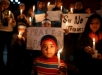 A boy holding a candle attends a candle light vigil in Kathmandu, December 17, 2014, for the students killed at the military-run Army Public School in Peshawar. Pakistan woke up to a day of mourning on Wednesday after Taliban militants killed 132 students in a grisly attack which shocked the nation and put pressure on the government to do more to tackle the insurgency.