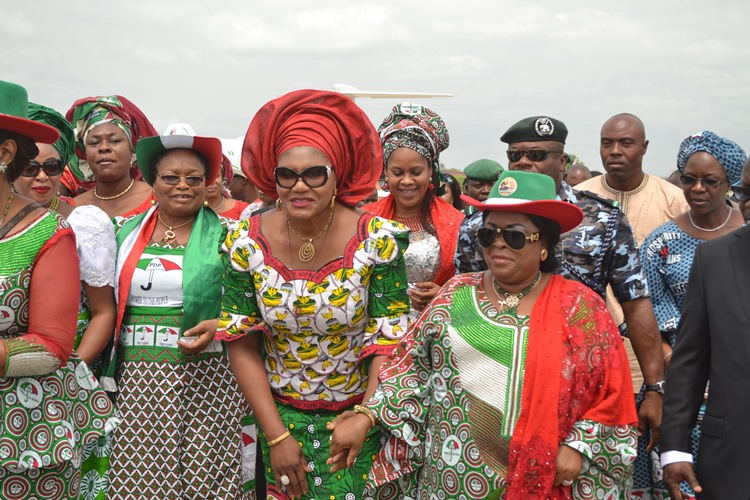 Wife of the Governor of Anambra State, Chief (Mrs.) Ebelechukwu  Obiano welcoming Mama Peace and First Lady of Nigeria, Dame Patience Jonathan on arrival for the Women Rally in Onitsha