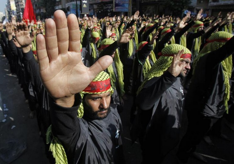Lebanese Hezbollah supporters gesture as they march during a religious procession to mark Ashura in Beirut's suburbs November 14, 2013. Ashura, which falls on the 10th day of the Islamic month of Muharram, commemorates the death of Imam Hussein, grandson of Prophet Mohammad, who was killed in the 7th century battle of Kerbala. REUTERS/Sharif Karim (LEBANON - Tags: POLITICS RELIGION) - RTX15D1C