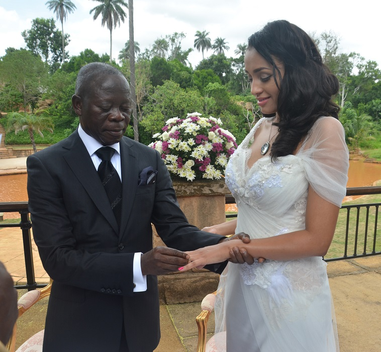 Governor Adams Oshiomhole slips puts a ring on the finger of fomer Miss Iara Fortes at a private marriage registry at Iyamho, Etsako West Local Government Area of Edo State, on Friday