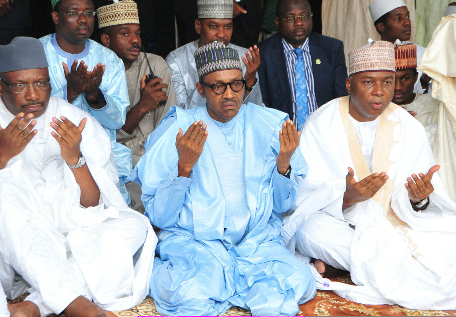 President  Muhammadu Buhari (middle), the Senate President, Dr. Abubakar Bukola Saraki and former Chief of Army Staff, Lt.  Gen. Abdulrahman Dambazau performing Eid-el Fitri prayer at the National Prayer  Ground  along Airport road Abuja, yesterday.