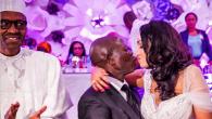 Oshiomole kissing his new wife - President Buhari clapping