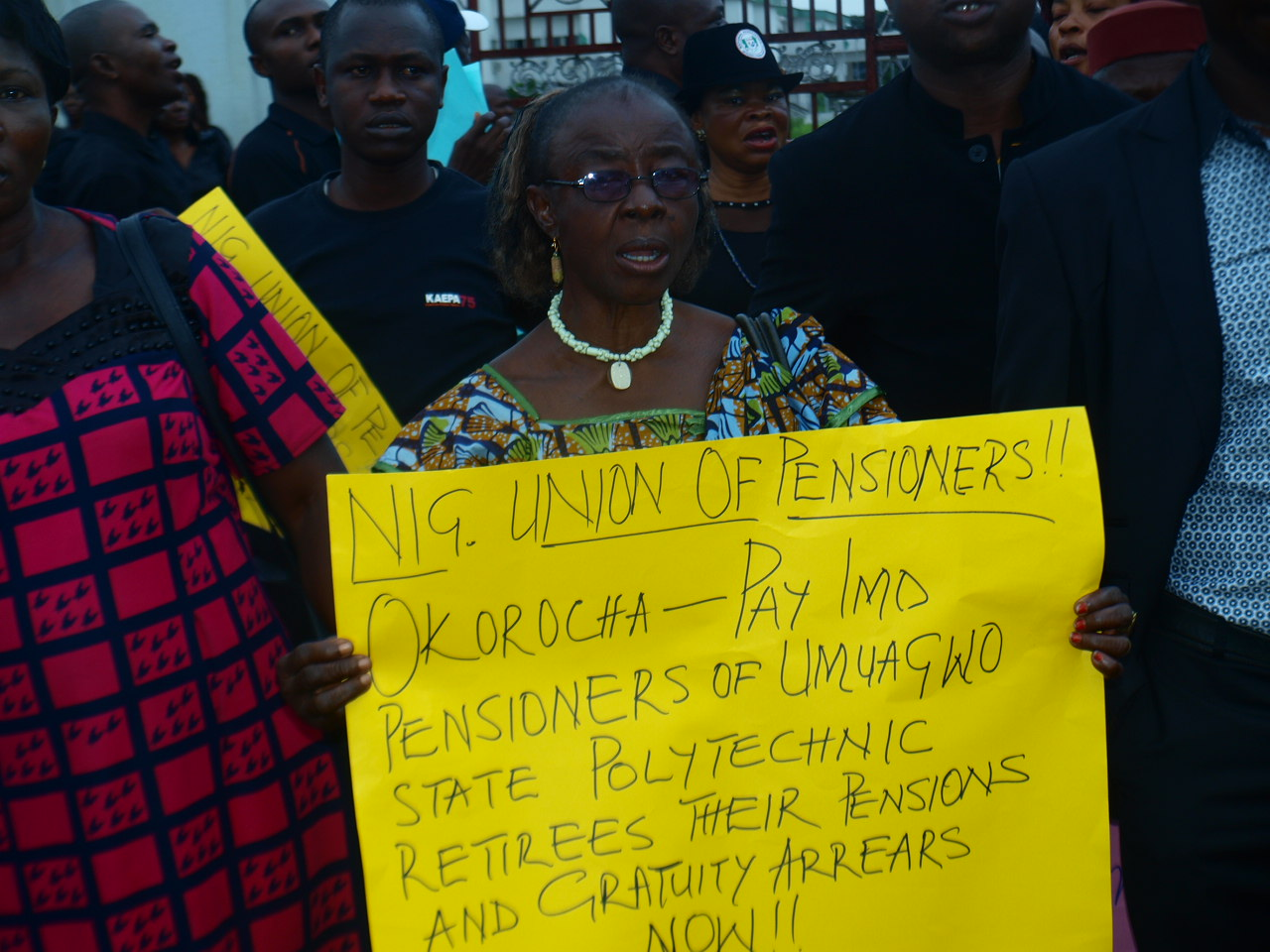 Workers and pensioners of Imo State barricading the gates of the state house of Assembly while protesting against the plan by the legislature to enact law to privatize parastatals