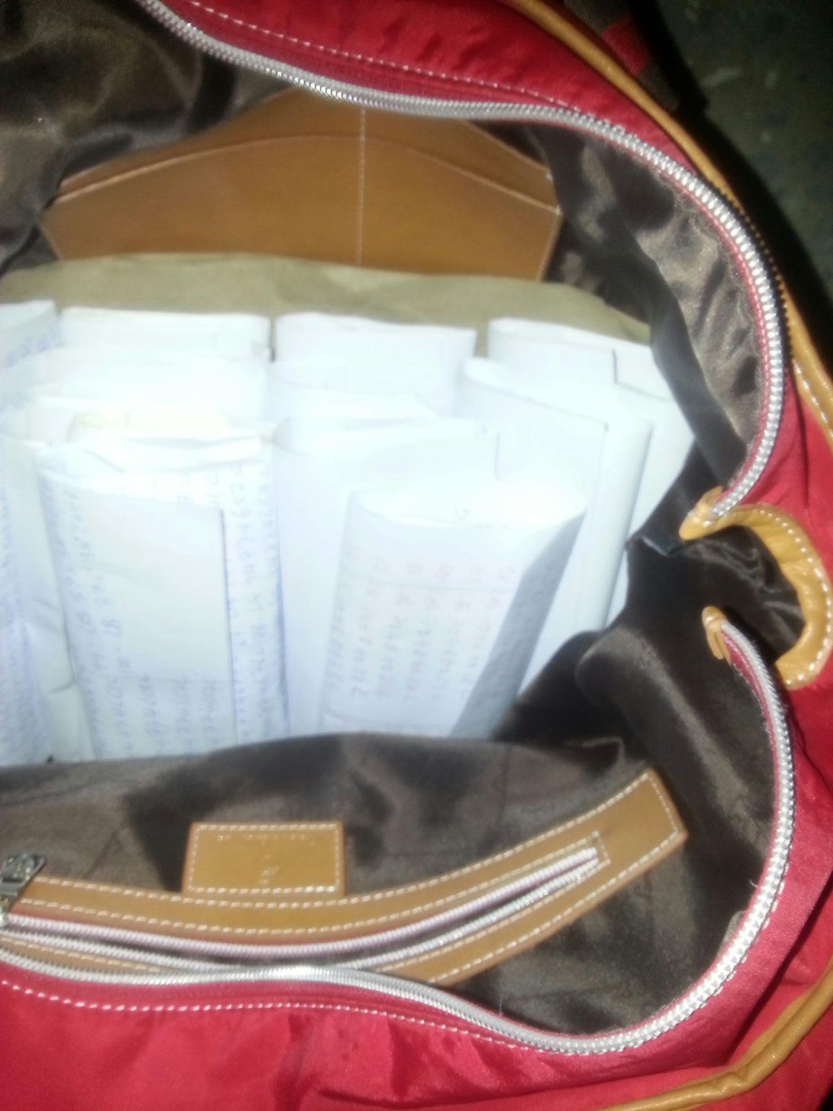 the money inside white envelopes in her bag
