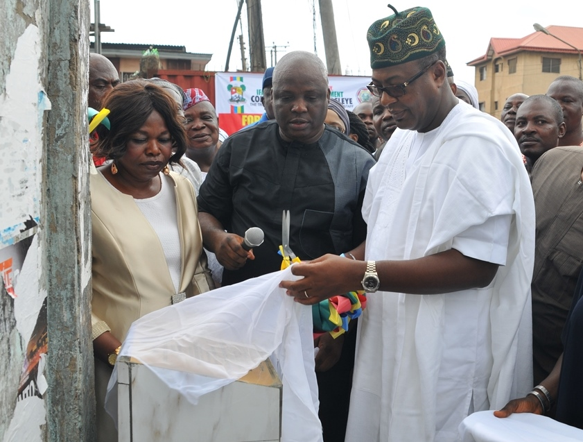 R-L: Representative of Lagos State Governor, Commissioner for Tourism, Arts & Culture, Mr. Folorunsho Folarin Coker; Executive Secretary, Ifako Ijaiye Local Government, Hon. Olurotimi Adeleye and Head, local Government Administration, Alhaja Kudirat Aderonke-Bello during the unveiling of plaque to commission Oluwasijibomi/Folorunsho Street, Ifako, Lagos, on Tuesday, May 17, 2016.