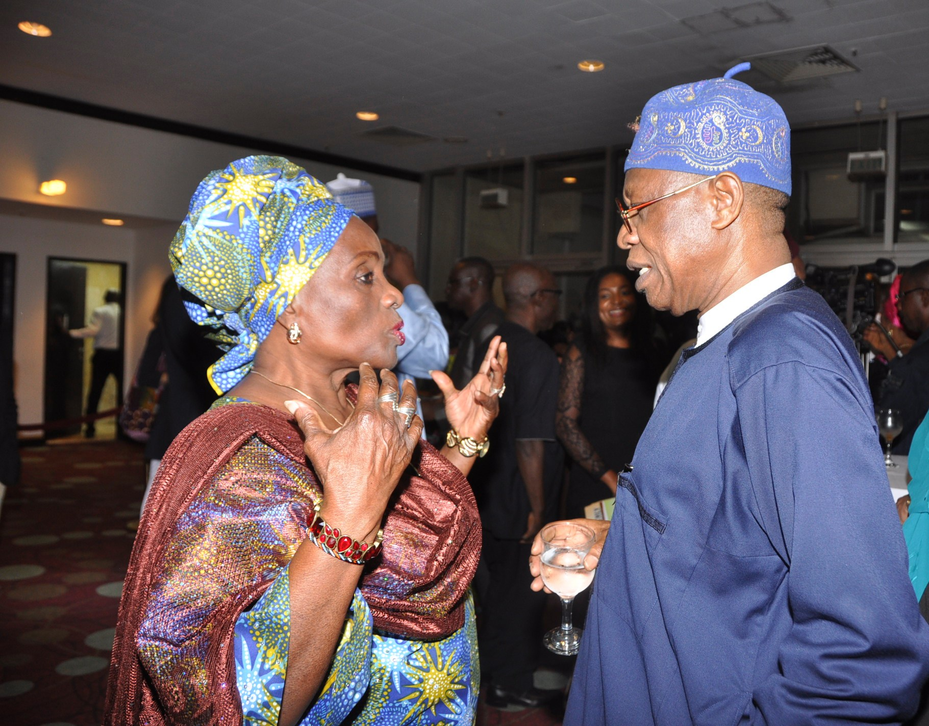 From left - Taiwo Ajayi Lycett and Minister of Information and Culture Lai Mohammed, after the command screening of the film OLOIBIRI in Abuja on Thursday night