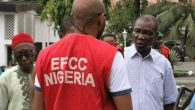 prince-benjamin-apugo-r-with-an-efcc-agent-during-his-arrest