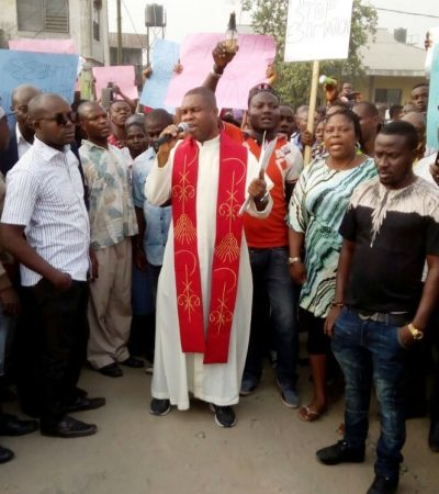Catholic Priest Leads Protest Against Power Black Out In Sapele, Delta State