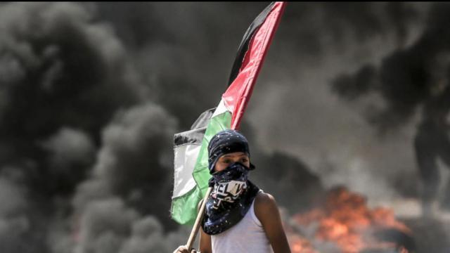 Palestinians bury dead after bloodiest Gaza day since 2014