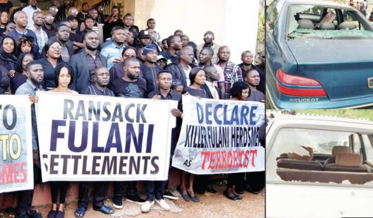 Plateau Massacre: Jos Protesters Chase Officials, Stone Vehicles, Offices In Govt House