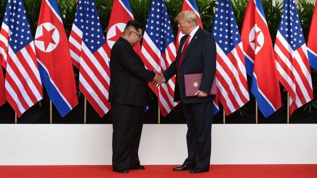 Kim Jong-un and Donald Trump shaking hands
