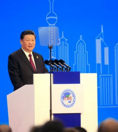 Xi Jinping vows to open up China to trade and makes veiled criticism of Donald Trump