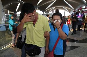 Malaysia says jet may have turned back, search expanded
