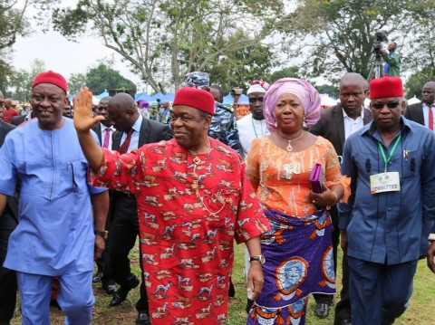 Abia state governor, Theodore Orji acknowledging greetings from the large crowd on his arrival at Bende Local Government headquaters in Bende LGA for the 2014 youth empowerment programme of Arochukwu, Ohafia and Bende at Bende Local Government headquaters. With him from L-R are Member representing Bende in the state house of assembly, Hon. P.C.Onyegbu, Lady Mercy Orji wife of the governor and Chief Oni Igbokwe T.C.Chairman of Arochukwu LGA.