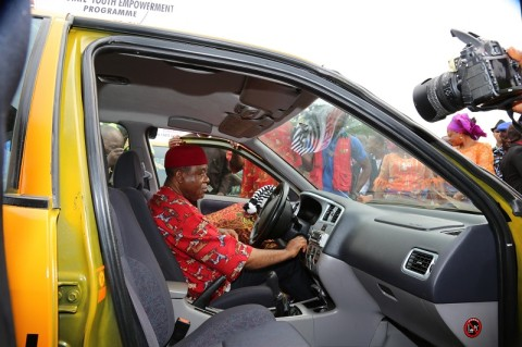 Abia state governor, Theodore Orji test driving one of the 200 vehicles during the 2014 youth empowerment programme of Arochukwu, Ohafia and Bende at Bende Local Government headquaters in Bende LGA.