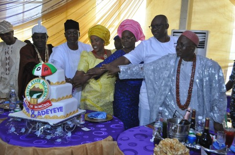 (L-R) Chief Ebenezer Babatope, Arinjale of Ise-Ekiti, Oba Adetunji Ajayi, Minister of State for Works, Prince Adedayo Adeyeye, his wife, Princess Adetomilola, Wife of Ekiti State Governor-Elect, Mrs Feyisetan Fayose, the Governor-Elect, Dr Ayodele Fayose and the Oore of Otun-Ekiti, Oba Adedapo Popoola cutting the cake in celebration of Adeyeye's appointment as a minister in Ise-Ekiti on Saturday