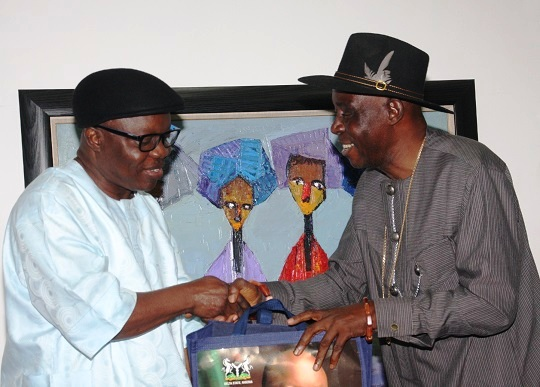 Governor Emmanuel Uduaghan of Delta State (Left) and Chief. Eddie Ugbomah, Former Chairman of Nigeria Film Corporation during a courtesy call to the Governor.