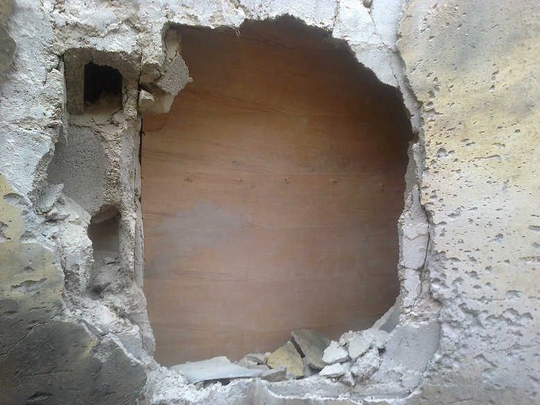 DAMAGED WALL AT THE SCENE OF THE BOMB BLAST
