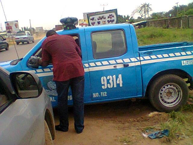 FRSC operative with a driver opposite their office