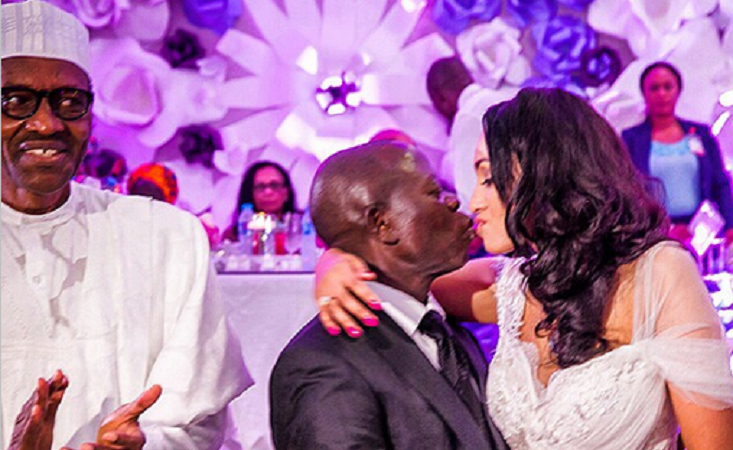Oshiomole kissing his new wife - President Buhari clapping