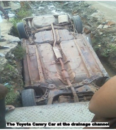 Man Escapes Death As Car Overturn Into Abandoned Drainage Channel In Aba