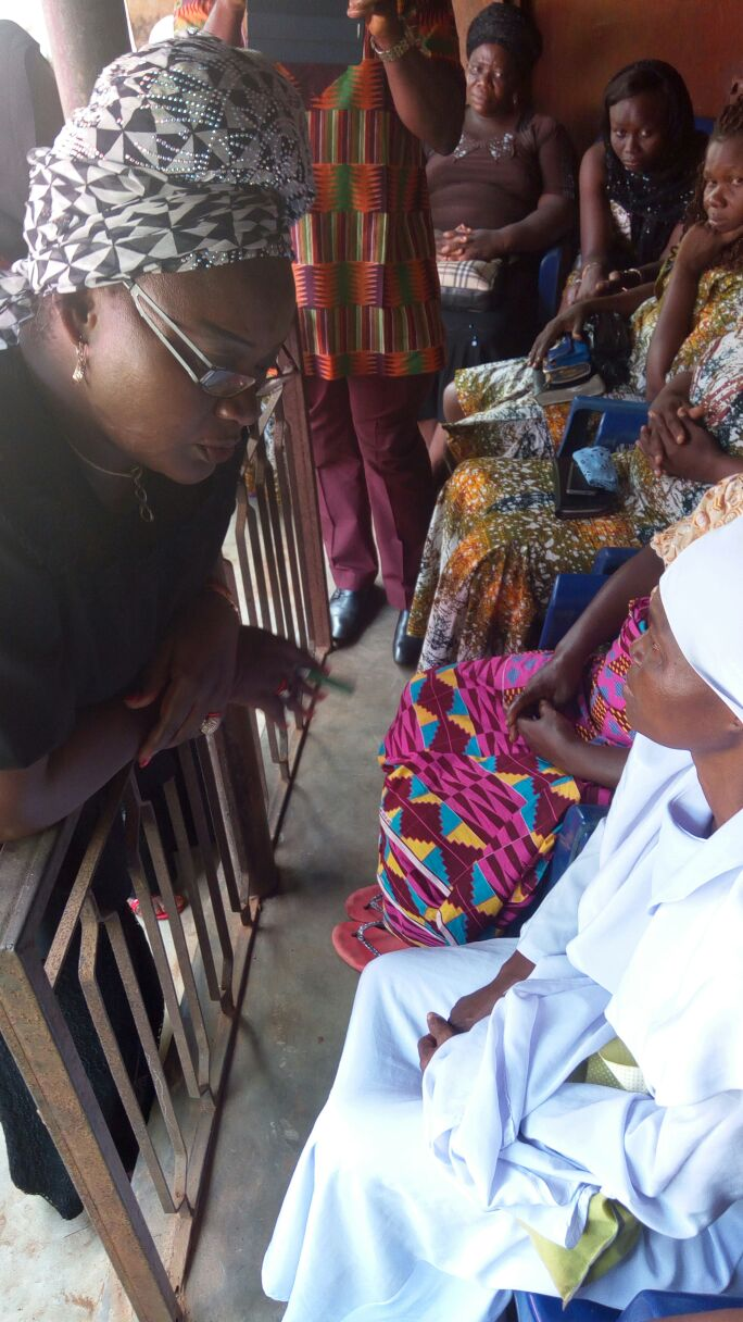 Rep of the Governor, Commissioner for Women Affairs Dr Victoria Chikwelu at the burial - consoling the family