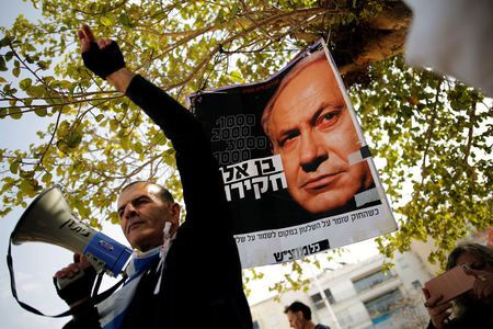 Israeli protesters urge Netanyahu to step down over bribery allegations