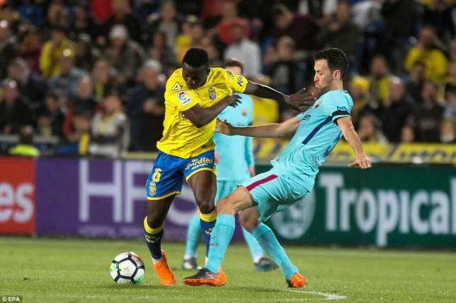 Oghenekaro Etebo and Sergio Busquets