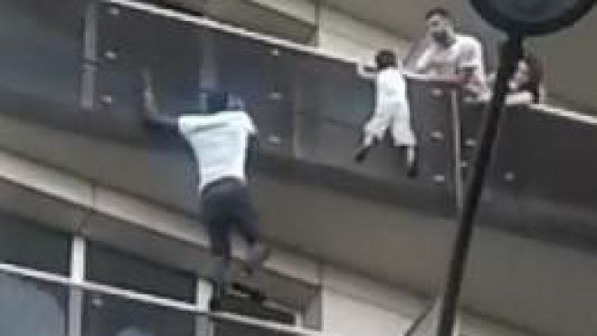 Father of boy saved by Paris 'Spiderman' convicted for negligence