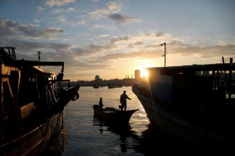 Palestinians pray for fish as Israel opens deeper waters