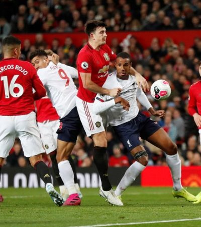 Liverpool winning streak ends with draw at Manchester United